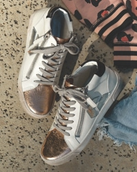 overhead shot of white P448 sneakers with metallic and black details