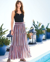 woman in striped maxi skirt with black tank by the pool