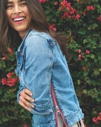 woman in jean jacket with side zipper